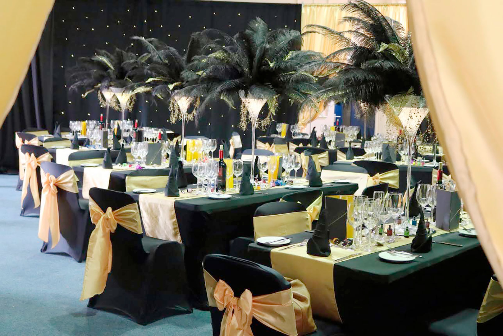 Black Chair Cover With Gold Sash and Ostrich Feather Centrepiece Giant Martini Glass